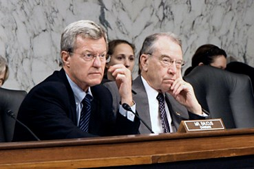 Sen. Max Baucus (D-MT) (left) sits next to Sen. Charles Grassley (R-IA).