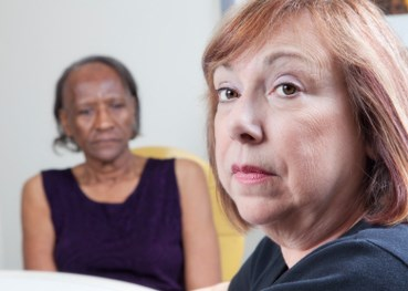 Dozens of Alzheimer's care workers face more than 70 charges related to abuse and neglect