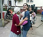 Liza dancing with a resident at a nursing home in Guatemala.