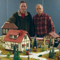 Win Garland (l) and Ron Reinbold view their work.