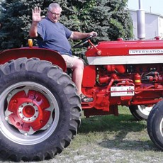 Residents cheer tractor parade