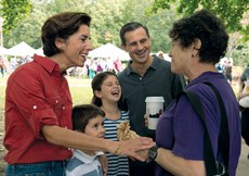 Gov. Gina Raimondo, (far left), is pushing to overhaul nursing home reimbursement in her state.