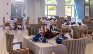 Ample amounts of natural light and bright colors enliven the Venetian Care & Rehabilitation Center. Each floor also has multiple kitchen units, in addition to the building's formal dining areas.