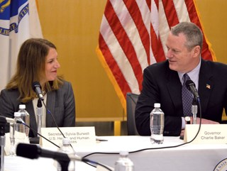 The office of Gov. Charlie Baker announced a $52.5 billion Medicaid waiver deal in December. He's pictured here with HHS Secretary Sylvia Burwell.