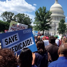 Protestors rally at the U.S. Capitol on Tuesday over potential cuts to Medicaid.