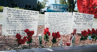 Messages were left outside of The Rehabilitation Center of Hollywood Hills, where nine people died after the facility lost air conditioning in the wake of Irma.