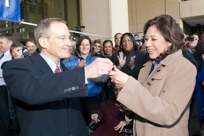Hilda Solis accepts keys to her new office from Ed Hugler. Photo: Shawn Moore, Dept. of Labor.