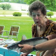 Resident Audrey Higginbotham marvels at a big catch.