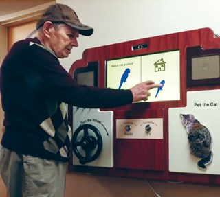 The tool is reiminiscent of an old-fashioned radio or TV to help residents feel comfortable using it.