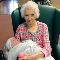 A resident at a Kentucky facility holds her new baby